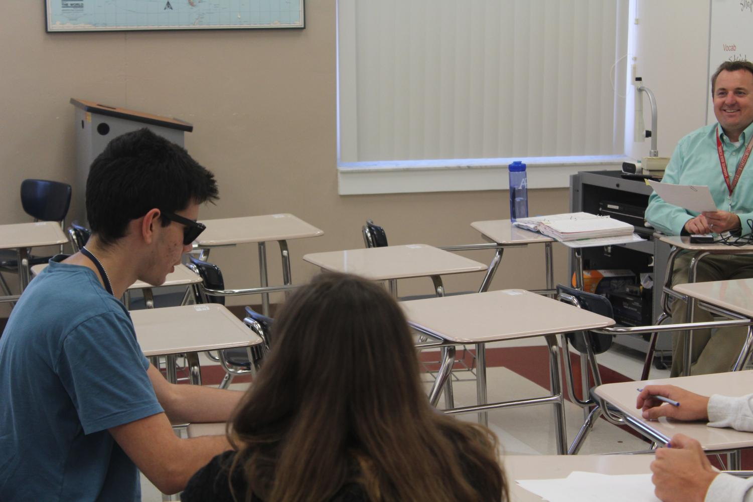 Mr. Murry along with his fellow members in A-Team, talking among one another. Photo Credit: Zyonn Singleton