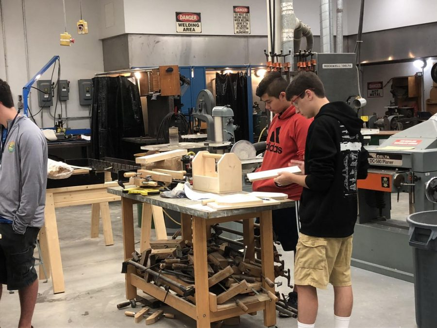 Tools+for+the+future%21+%0A%0AMr.+Peters%E2%80%99+manufacturing+class+assembles+a+wooden+toolbox.+The+class+had+previously+cut+out+and+carved+pieces+of+wood+by+themselves+learning+the+basics+of+how+to+operate+machinery+in+a+workplace+environment.+%E2%80%9CI+like+that+I+can+teach+students+something+they+can+actually+use+in+the+real+world%E2%80%9D+stated+Mr.+Peters.