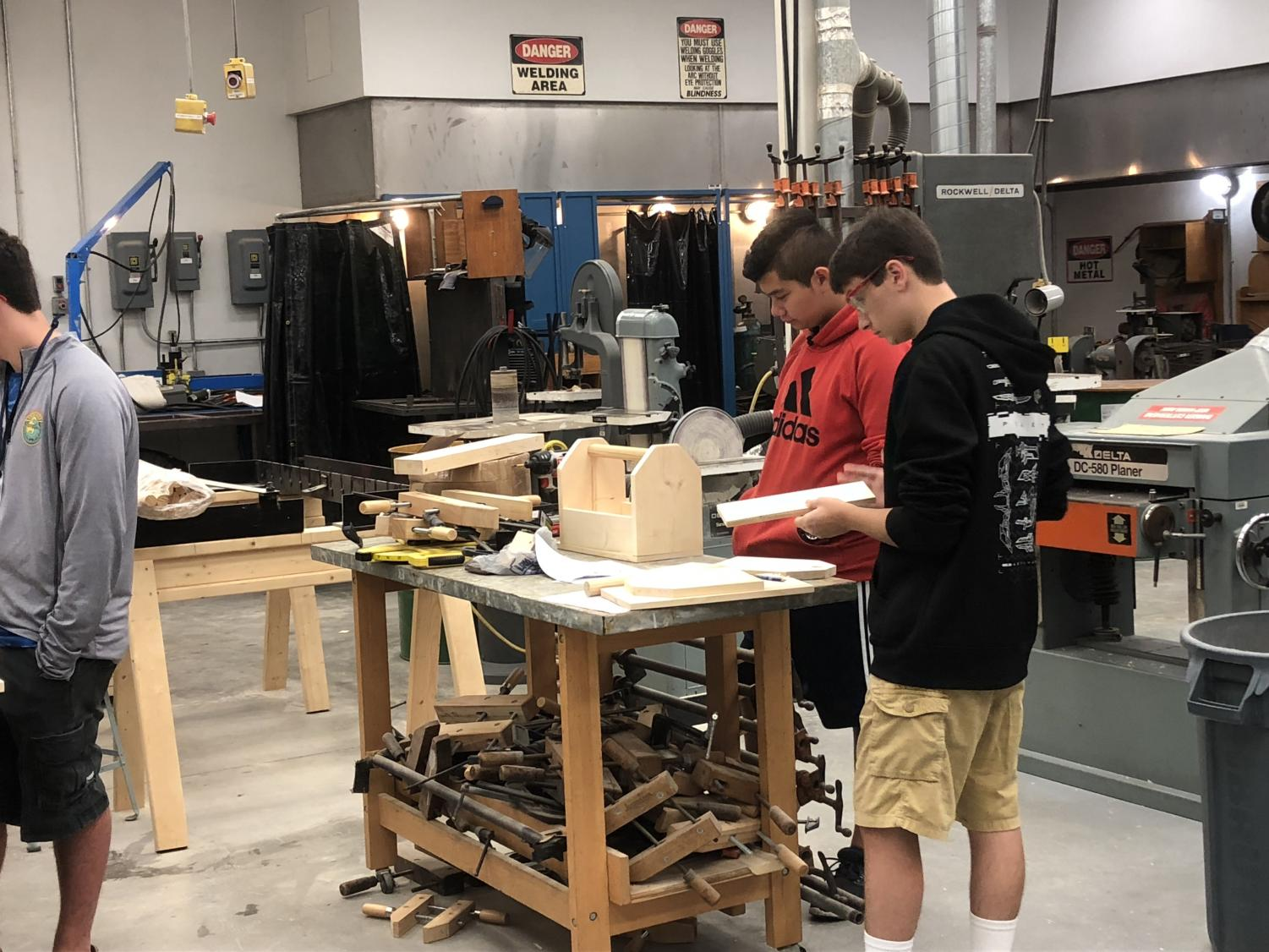 "Tools for the future!   Mr. Peters' manufacturing class assembles a wooden toolbox. The class had previously cut out and carved pieces of wood by themselves learning the basics of how to operate machinery in a workplace environment. ""I like that I can teach students something they can actually use in the real world"" stated Mr. Peters."