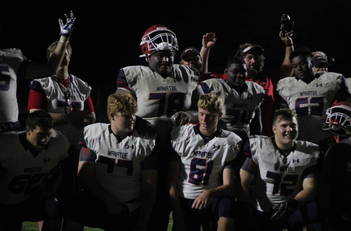 Go Canes Go: They will play the district championship this coming Friday on Nov. 8. At the Venice football game last Friday, the varsity football team rejoices in their win.