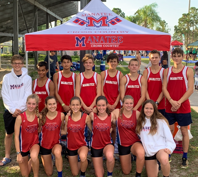 Ready to race- The boys and girls cross country teams practice for hours everyday to prepare for their meets. All of their challenging practices lead them to success at the district meet, where they both advanced to the regional meet.