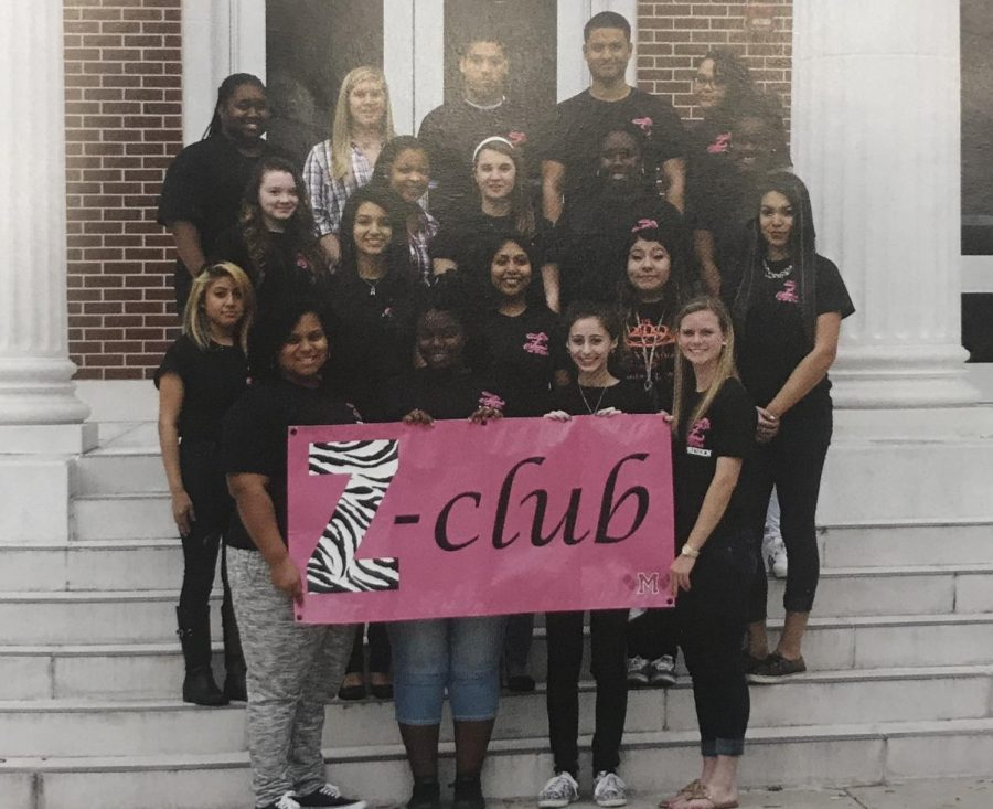 The 2017 Z-club consists of a large amount of girls and 2 guys who discuss empowerment of women and ways they can help.