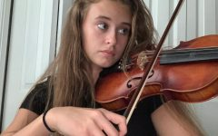 "Practicing Smartly! Junior Megan Watters practices one of her pieces for the school orchestra. Watters has been an avid player since the 6th grade and contributed to the orchestra's Excellence grade. ""I believe practice makes perfect, but it has be 100% dedicated practice,"" said Watters."