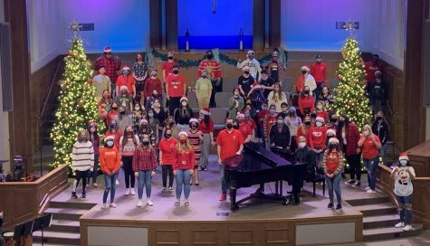 "Chorus students come together for their winter recording. Jomisko tried to social distance everyone as much as possible on the stage of West Bradenton Baptist Church. ""Without the soundproof walls our songs are heard at true capacity and I really love that sound,"" Angee Reyes (11) said."