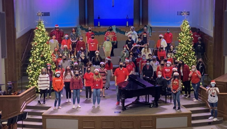 Chorus students come together for their winter recording. Jomisko tried to social distance everyone as much as possible on the stage of West Bradenton Baptist Church.